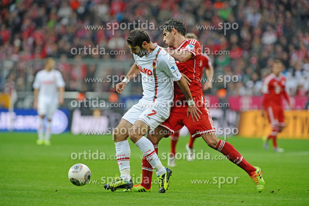 09.11.2013, Allianz Arena, Muenchen, GER, 1. FBL, FC Bayern Muenchen vs FC Augsburg, 12. Runde, im Bild Halil Altintop (FC Augsburg) gegen rechts Javier Martinez (FC Bayern Muenchen) // during the German Bundesliga 12th round match between FC Bayern Munich and FC Augsburg at the Allianz Arena in Muenchen, Germany on 2013/11/09. EXPA Pictures &copy; 2013, PhotoCredit: EXPA/ Eibner-Pressefoto/ Stuetzle<br /> <br /> *****ATTENTION - OUT of GER*****