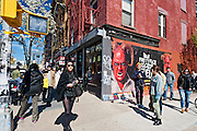 People walking on Bedford Avenue in the Williamsburg neighborhood in Brooklyn, New York in Spring.