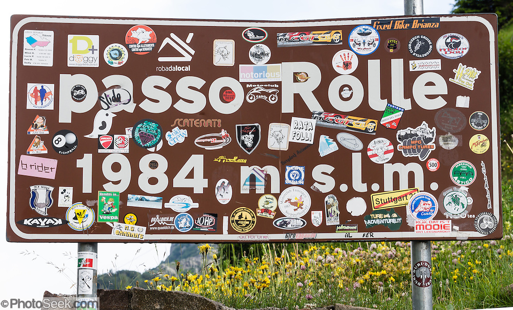 Passo Rolle sign plastered with stickers, Dolomites, Trentino province, Italy, Europe
