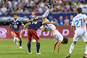 CHICAGO, IL - AUGUST 02: MLS All-Star and Orlando City FC Forward Dom Dwyer (14) and Real Madrid defender Jesus Vallejo (3) get tangled up in the second half during a soccer match between the MLS All-Stars and Real Madrid on August 02, 2017, at Soldier Field in Chicago, IL. The game ended in a 1-1 tie with Real Madrid winning on penalty kicks 4-2. (Photo By Daniel Bartel/Icon Sportswire)