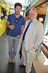 Left to right, Restauranteur RUSSELL NORMAN and RICHARD VINES Chief food critic from Bloomberg at a party to celebrate the opening of the Wahaca Southbank Experiment - a temporary restaurant made from 8 metal shipping containers, outside The Queen Elizabeth Hall, Southbank, London SE1 on 28th June 2012.