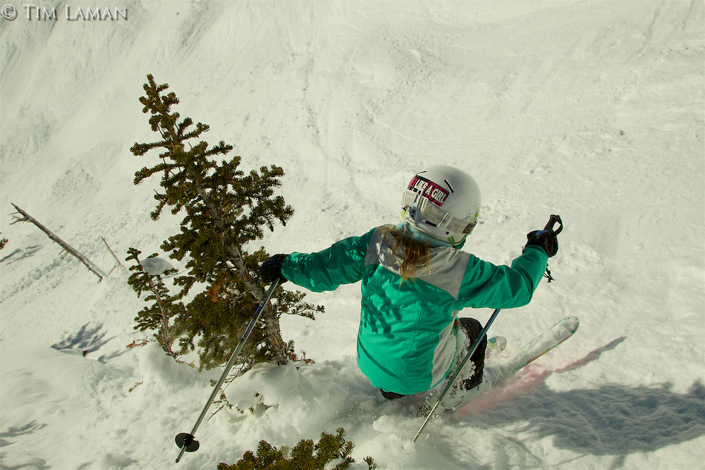 Jessica Laman (age 9) jumps into a steep ravine in Jackson Hole, Wyoming.<br />