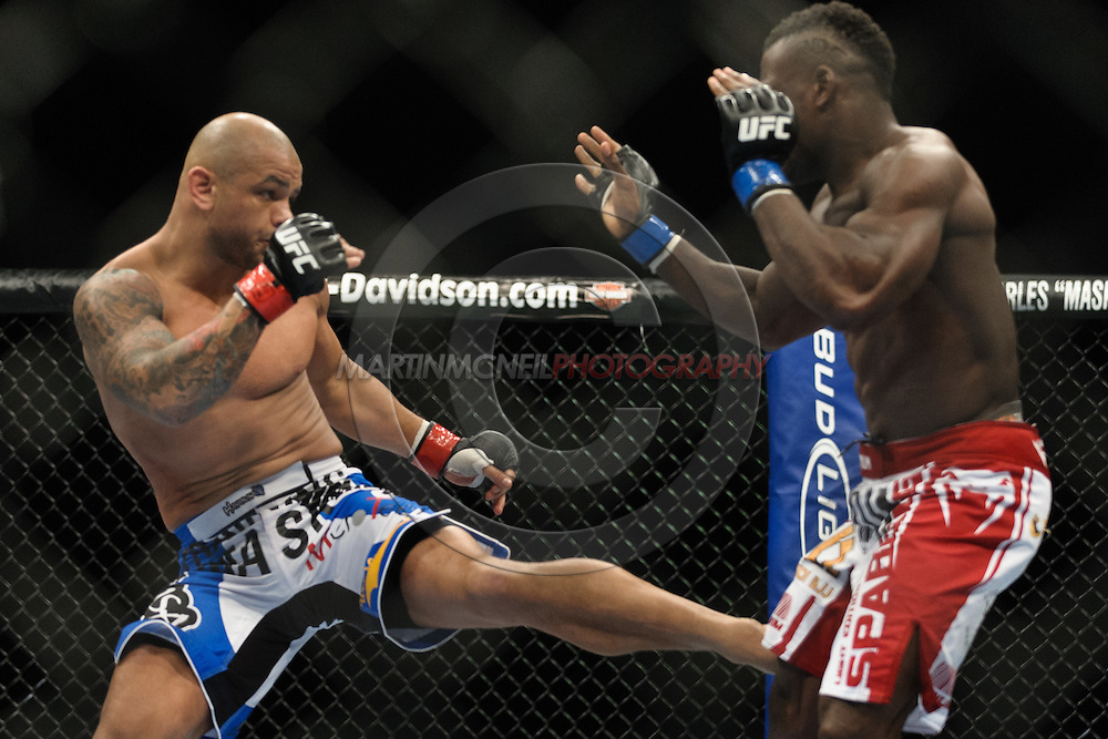 "BIRMINGHAM, ENGLAND, NOVEMBER 5, 2012: Thiago Alves (left) throws a kick to the leg of Papy Abedi during ""UFC 138: Munoz vs. Leben"" inside the National Indoor Arena in Birmingham, United Kingdom"