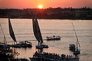 Egypt. Louxor - sunset . boats and felouqs on the Nile   Louxor - Egypte    /  coucher de soleil, bateaux et fellouques sur le nil  Louqsor - Egypt