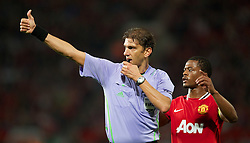 27.09.2011, Old Trafford, London, ENG, UEFA CL, Gruppe C, Manchester United (ENG) vs FC Basel (SUI), im Bild Manchester United's captain Patrice Evra and Paolo Tagliavento in action against FC Basel 1893 // during the UEFA Champions League game, group C, Manchester United (ENG) vs FC Basel (SUI) at Old Trafford stadium in London, United Kingdom on 2011/09/27. EXPA Pictures © 2011, PhotoCredit: EXPA/ Propaganda Photo/ David Rawcliff +++++ ATTENTION - OUT OF ENGLAND/GBR+++++