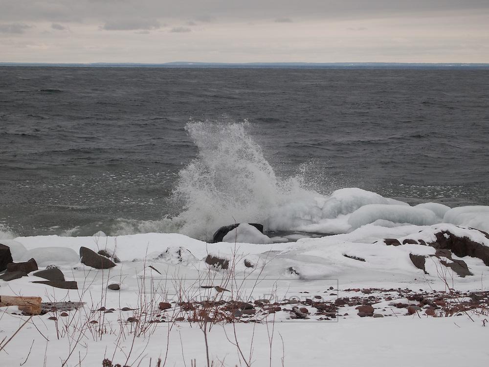 Rocky, Ice-covered shoreline of Duluth on Lake Superior