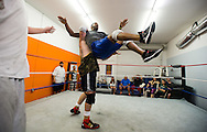 Andrew Foster (left), of Port St. Lucie, prepares to slam Travis Kelman, also of Port St. Lucie, onto the matt during a rehearsal bout at a Championship Wrestling Entertainment class at 1035 SW Biltmore St. in Port St. Lucie on Wednesday, April 22, 2015. (XAVIER MASCAREÑAS/TREASURE COAST NEWSPAPERS)