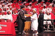 Graduates receive their diploma from principal Terry Logan during the Trotwood-Madison High School commencement at the Victoria Theatre in downtown Dayton, May 29, 2012.