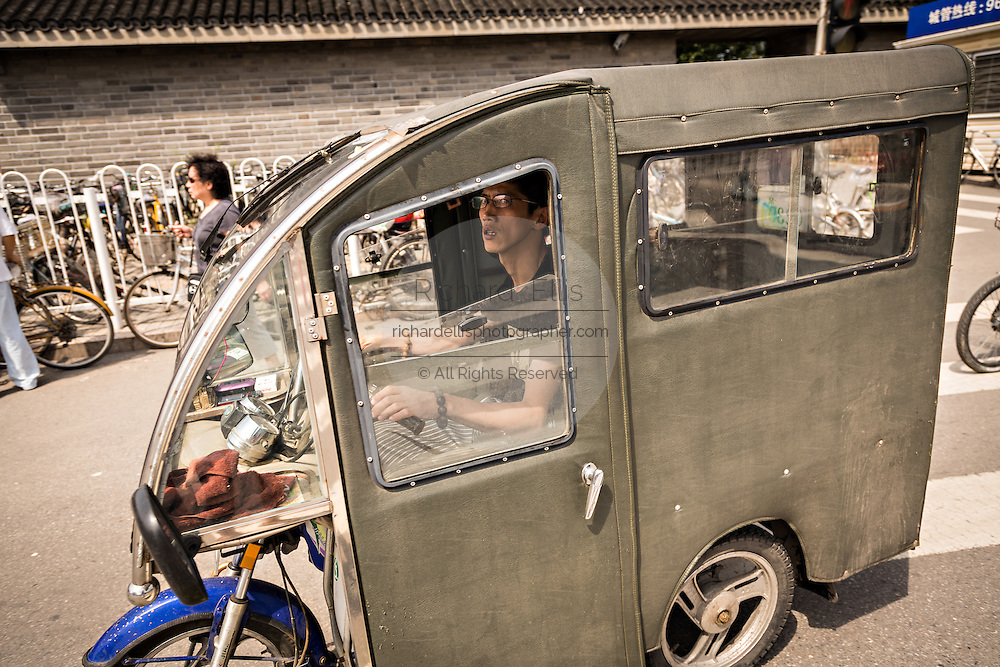 An enclosed scooter during summer in Beijing, China