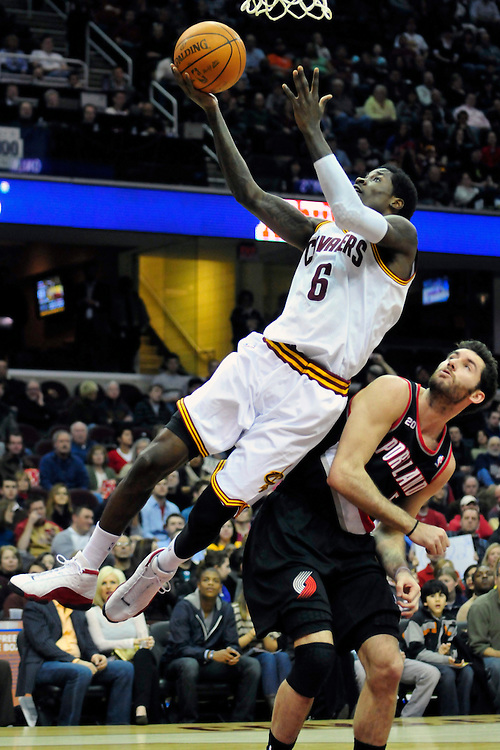 Feb. 5, 2011; Cleveland, OH, USA; Cleveland Cavaliers guard Manny Harris (6) shoots over Portland Trail Blazers shooting guard Rudy Fernandez (5) during the second quarter at Quicken Loans Arena. Mandatory Credit: Jason Miller-US PRESSWIRE