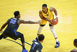 Nov 9, 2018; Morgantown, WV, USA; West Virginia Mountaineers forward Sagaba Konate (50) looks to pass the ball during the first half against the Buffalo Bulls at WVU Coliseum. Mandatory Credit: Ben Queen-USA TODAY Sports