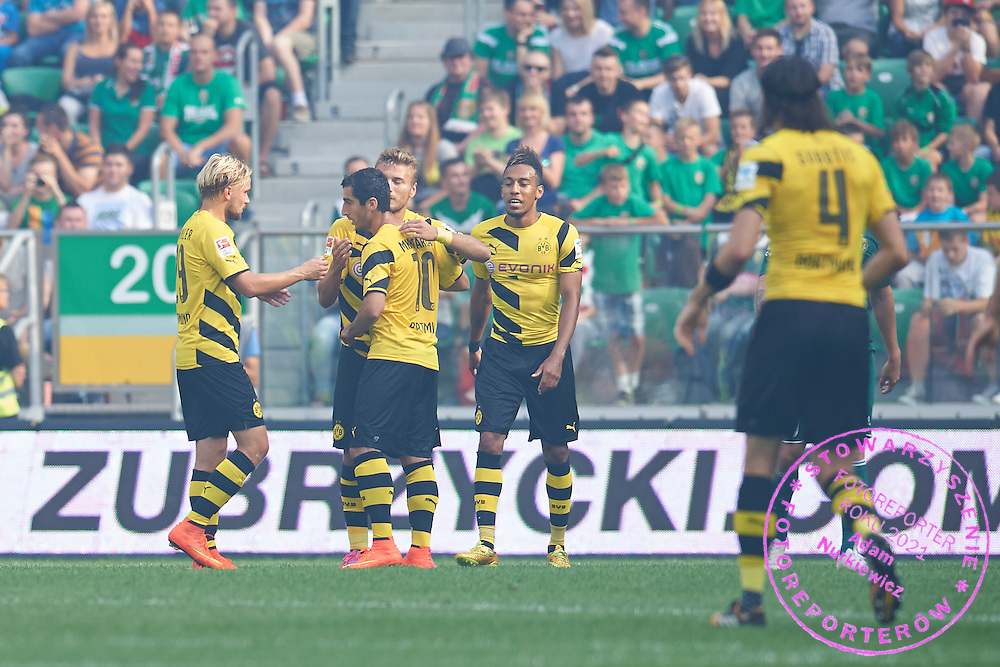 (C) Henrikh Mkhitaryan of Dorussia Dortmund celebrates with team mates after scoring during international friendly soccer match between WKS Slask Wroclaw and BVB Borussia Dortmund on Municipal Stadium in Wroclaw, Poland.<br /> <br /> Poland, Wroclaw, August 6, 2014<br /> <br /> Picture also available in RAW (NEF) or TIFF format on special request.<br /> <br /> For editorial use only. Any commercial or promotional use requires permission.<br /> <br /> Mandatory credit:<br /> Photo by &copy; Adam Nurkiewicz / Mediasport