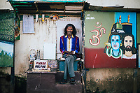 Fort Kochi, India -- February 13, 2018: A portrait of Jaleel, a street artist who lives near Mahatma Gandhi Beach in Fort Kochi.