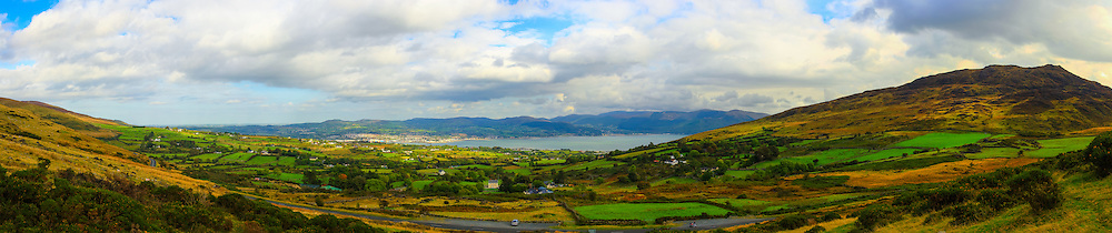 View from Corrakit near Omeath looking down towards Carlingford Lough, Warrenpoint and the Mourne Mountains, flanked by Slieve Foy on the right hand side. Image composed of 13 photos at 35mm in portrait orientation. You can zoom in and take a closer look to see what this could look like on your wall here http://adambrooks.photoshelter.com/#!/p/i0000vv7bctdsnyc<br /> <br /> Available in sizes ranging from 8&quot;x36&quot; - 20&quot;x90&quot; (20cmx92cm - 51cmx229cm).