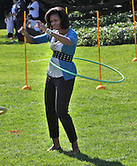 First lady Michelle Obama hosts a healthy Kids Fair on the South Lawn of the White House to promote healthy activities and food. photograph: Dennis Brack
