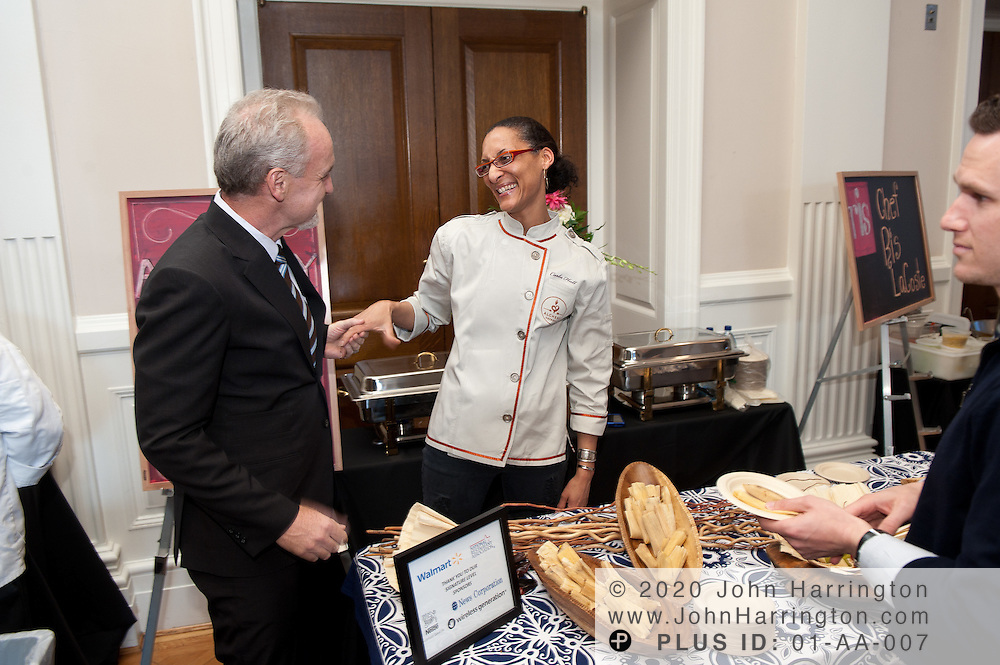 Chef Carla Hall of Alchemy and Bravo's Top Chef All Stars greets Common Threads Founder Chef Art Smith (Art and Soul) at the Common Threads World Festival at the Carnegie Institution in Washington, DC on April 6th, 2011, brought together influential area chefs, politicians, and food enthusiasts for a fundraiser for after-school programs in Washington.