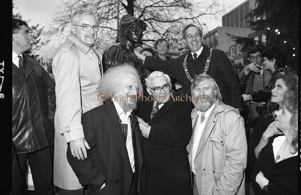 "Molly Malone Statue Unveiled. (R93)..1988..20.12.1988..12.20.1988..20th December 1988..""Dublin's Fair City"" received a millenniun gift to commemorate her most famous daughter, Molly Malone, when Jurys Hotel Group plc presented a specially commissioned sculpture to the people of Dublin. The sculpture was formally handed over by Michael McCarthy, MD,Jurys Hotel Group, to the Lord Mayor of Dublin, Councillor Ben Briscoe, TD, in an unveiling ceremony today at the corner of Grafton Street, Suffolk Street and Nassau Street..Molly Malone was created and fashioned in her traditional 17th century dress by Dublin born artist, Jeanne Rynhart, who was selected from a number of entries for the statue design, by the Dublin Millennium Board...Pictured from left, Michael McCarthy, Jurys, Eamonn Campbell, Frank Feely, City Manager, John Sheehan and Lord Mayor, Ben Briscoe."