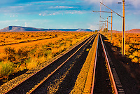 """Train tracks, Rovos Rail train  """"Pride of Africa"""" crosses the Great Karoo Desert on it's journey between Pretoria and Cape Town, South Africa."""