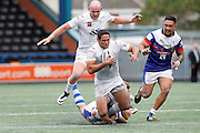 Hep Cahill  gets tackled as he makes a break for the try line during the First Utility Super League match between Widnes Vikings and Wakefield Wildcats at the Select Security Stadium, Halton, United Kingdom on 21 August 2016. Photo by Craig Galloway.