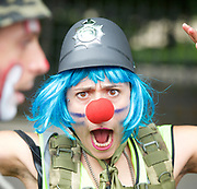 A UAF supporter dressed as a clown <br /> <br /> <br /> English Defence League <br /> protest at Charing Cross with a counter Unite Against Fascism protest on Victoria Embankment <br /> 24th June 2017 <br /> <br /> General View and Metropolitan Police containing the march. <br /> <br /> Photograph by Elliott Franks <br /> Image licensed to Elliott Franks Photography Services