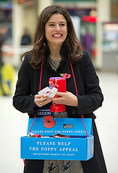 © London News Pictures. 06/11/2013 . London, UK.  MIRIAM GONZALEZ DURANTEZ and her husband Deputy Prime Minister Nick Clegg (Not pictured) selling poppies at Charring Cross Station in central London to raise money for the Poppy Appeal ahead of remembrance sunday this weekend.  Photo credit : Ben Cawthra/LNP
