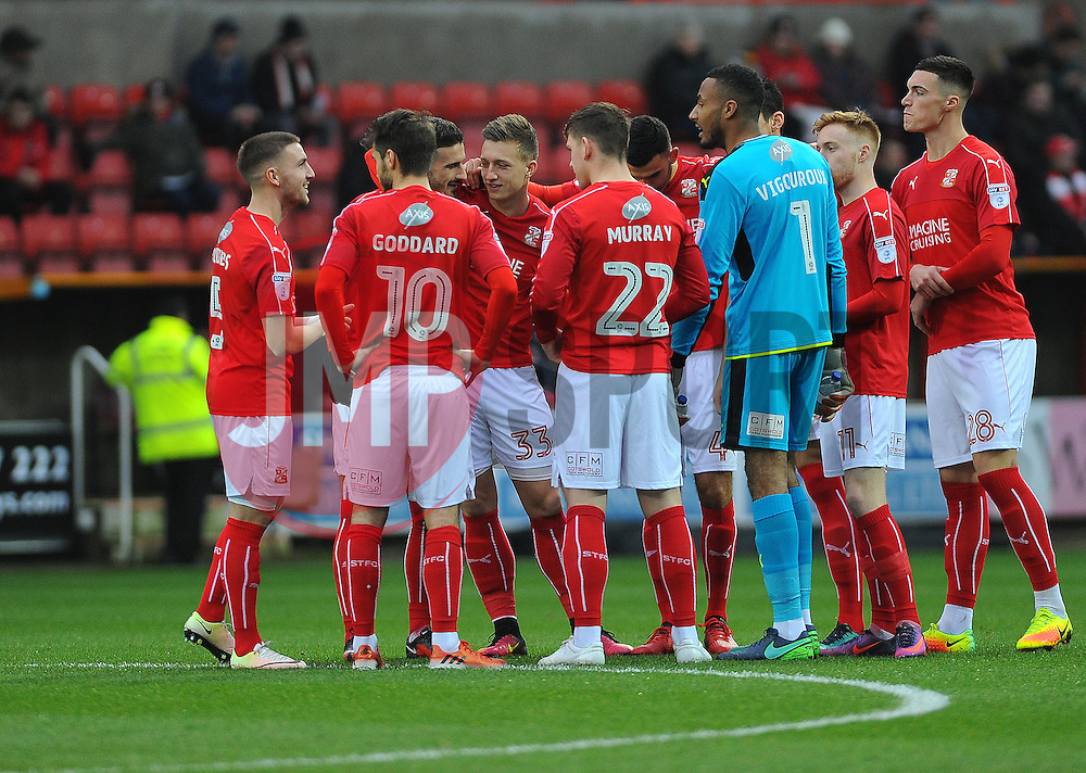 Swindon Town players huddle to together before kick-off - Mandatory by-line: Nizaam Jones/JMP - 07/01/2017 - FOOTBALL - County Ground - Swindon, England - Swindon Town v Shrewsbury Town - Sky Bet League One