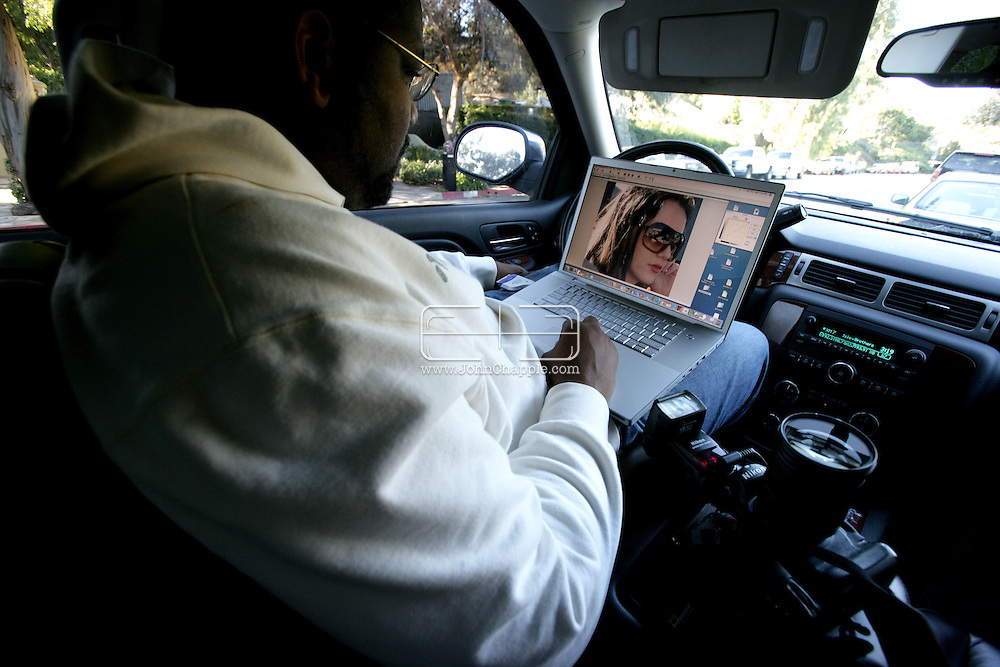 30th January 2008, Los Angeles, California.  Paparazzi photographer Giles Harrison transmits his digital pictures of Britney Spears from his car. PHOTO © JOHN CHAPPLE / REBEL IMAGES.john@chapple.biz    www.chapple.biz
