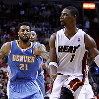 19 March 2011: Miami Heat power forward Chris Bosh (1) drives past Denver Nuggets small forward Wilson Chandler (21) during the Miami Heat 103-98 victory over the Denver Nuggets at the AmericanAirlines Arena, Miami, Florida, USA.