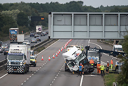 © Licensed to London News Pictures. 26/08/2017. Milton Keynes, UK. The lorry being recovered. The scene on the M1 motorway near Milton Keynes after a crash involving a minibus and two lorries. Police say that several people are dead and four others have been taken to hospital after the accident on the southbound carriageway in the early hours of this morning. Photo credit: Ben Cawthra/LNP