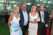 "Werner Grissmann (2nd fr. l.), former downhill skier, with family..Hangar-7, the spectacular new home of the Flying Bulls (""Red Bull"" owner Didi Mateschitz' collection of classic airplanes), opens with aeronautical highlights like Karlheinz Stockhausen's ""Helicopter String Quartet"", a production of the Salzburg Festival, and ""Taurus Rubens"", a spectacular Theater for Flying Machines."