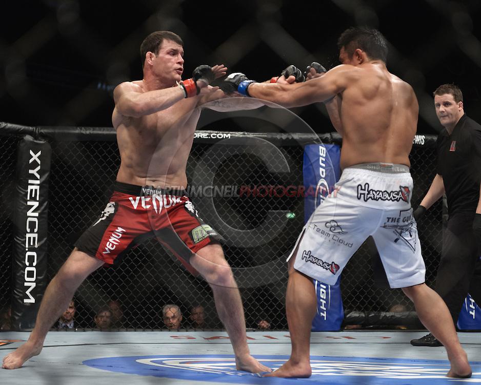 """LONDON, ENGLAND, OCTOBER 2010: Michael Bisping (left) and Yohihiro Akiyama trade blows during """"UFC 120: Bisping vs. Akiyama"""" inside the O2 Arena in Greenwich, London"""