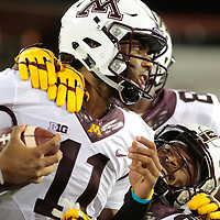 Minnesota quarterback Demry Croft (11) celebrates with teammates after scoring on a 64 yard run in the second half of an NCAA college football game against Oregon State, in Corvallis, Ore., Saturday, Sept. 9, 2017.  Minnesota won 48-14. (AP Photo/Timothy J. Gonzalez)