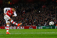 Alexis Sanchez of Arsenal scores his team's second goal against R.S.C Anderlecht to make it 2-0 during the UEFA Champions League match at the Emirates Stadium, London<br /> Picture by David Horn/Focus Images Ltd +44 7545 970036<br /> 04/11/2014