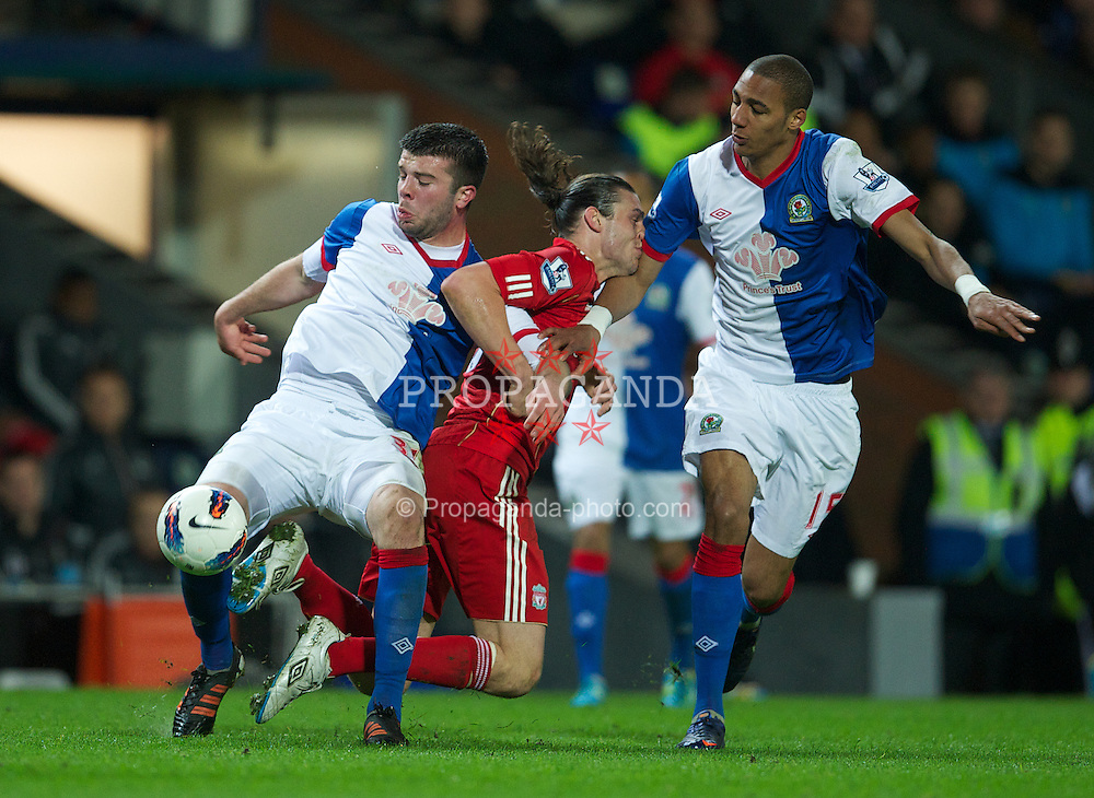 BLACKBURN, ENGLAND - Tuesday, April 10, 2012: Liverpool's Andy Carroll is muscled out by Blackburn Rovers' Grant Hanley and Steven Nzonzi during the Premiership match at Ewood Park. (Pic by David Rawcliffe/Propaganda)