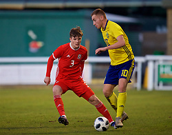 BANGOR, WALES - Saturday, November 17, 2018: Wales' Morgan Boyes (L) and Sweden's Dejan Kulusekvski during the UEFA Under-19 Championship 2019 Qualifying Group 4 match between Sweden and Wales at the Nantporth Stadium. (Pic by Paul Greenwood/Propaganda)