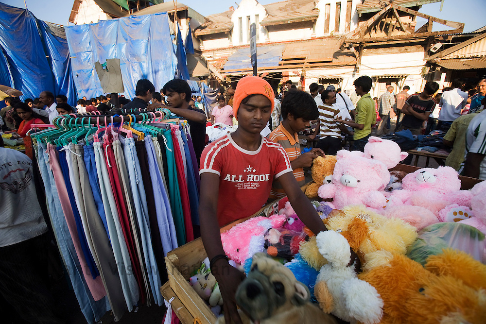 A shopkeeper arranges his stall on a street in Mumbai, on Sunday Dec. 28, 2008.  Photographer:Prashanth Vishwanathan