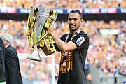 Hull City midfielder Ahmed Elmohamady (27) lifts the trophy during the Sky Bet Championship Play-Off Final between Hull City and Sheffield Wednesday at Wembley Stadium, London, England on 28 May 2016. Photo by Phil Duncan.