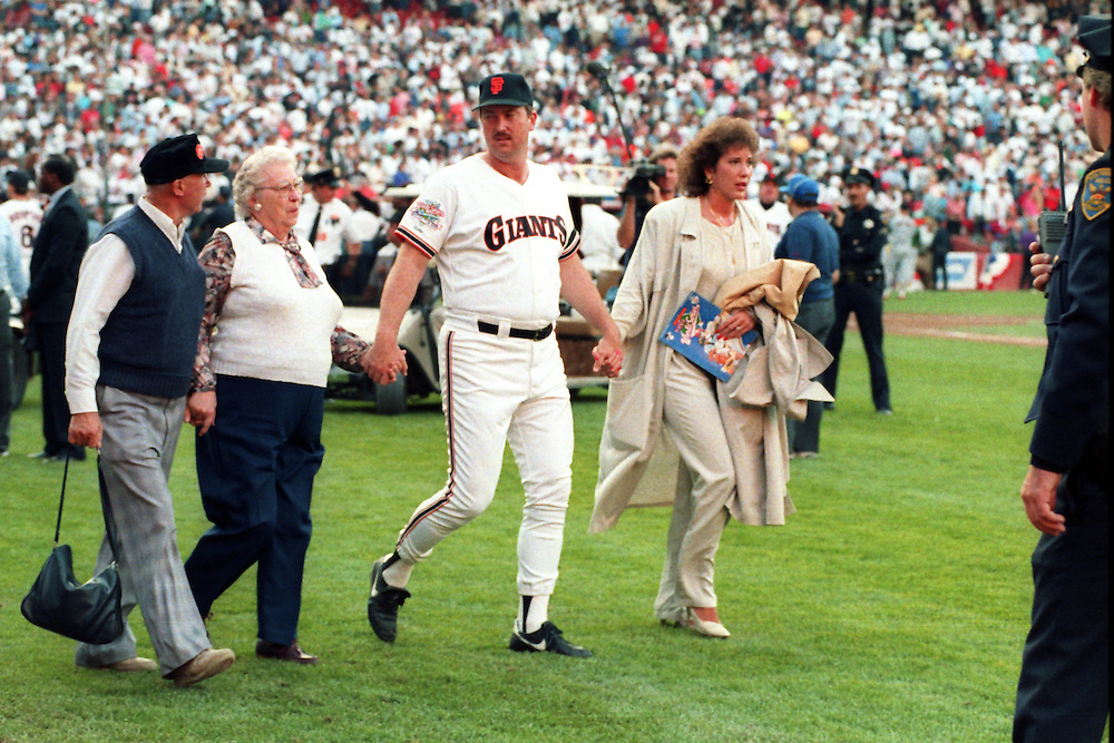 SAN FRANCISCO, CA-OCTOBER 1989: Rick Reuschel of the San Francisco Giants leaves the field with his family after a 6.9 magnitude earthquake cancelled Game 3 of the 1989 World Series between the San Francisco Giants and Oakland Athletics at Candlestick Park in San Francisco, California.  (Photo by Ron Vesely)