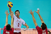 (L) Michal Winiarski from Poland in action during the 2013 CEV VELUX Volleyball European Championship match between Poland v Slovakia at Ergo Arena in Gdansk on September 22, 2013.<br /> <br /> Poland, Gdansk, September 22, 2013<br /> <br /> Picture also available in RAW (NEF) or TIFF format on special request.<br /> <br /> For editorial use only. Any commercial or promotional use requires permission.<br /> <br /> Mandatory credit:<br /> Photo by &copy; Adam Nurkiewicz / Mediasport