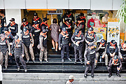 Apr. 19 2010 - BANGKOK, THAILAND: Thai riot police staged in front of a bank in the Silom financial district step aside to let a customer enter the bank. Hundreds of Thai soldiers, including reservists and front line units, and riot police moved into the Silom financial district Monday, not far from the red-shirts' main protest rally site, in Ratchaprasong. The heavy show of force is to prevent the Red Shirts from entering the Silom area. Many of soldiers were greeted as heros by workers in the area, who oppose the Red Shirts.   Photo by Jack Kurtz