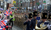 200 soldiers from the Royal Anglian Regiment exercise their right to march through Watford Town centre, Wednesday 11 March, with colours flying and drums playing. There was no repeat of the demonstrations that occured the previous day in Luton