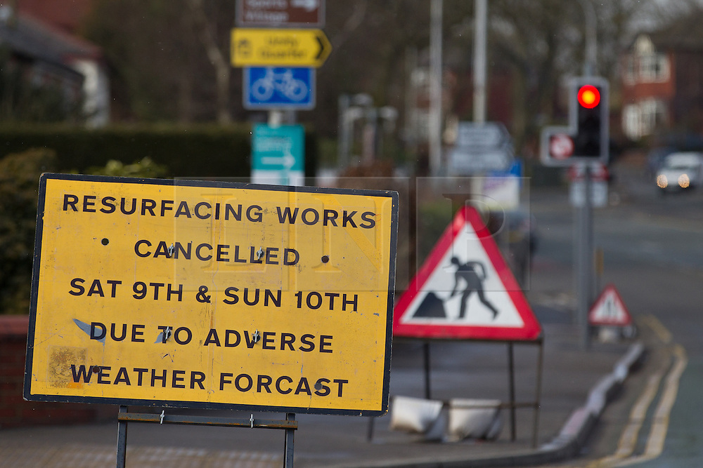 © Licensed to London News Pictures . 11/03/2013 . Manchester , UK . A misspelled sign that reads that roadworks are cancelled due to adverse weather forcast [sic] , on Bolton Road in Swinton , Greater Manchester as alternating spring sunshine and gusty snow flurries hit the north west of England . Photo credit : Joel Goodman/LNP