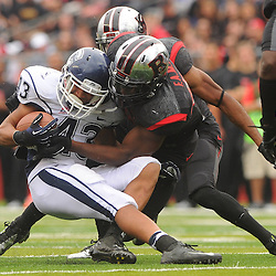 Oct 6, 2012: Rutgers Scarlet Knights linebacker Steve Beauharnais (42) tackles Connecticut Huskies running back Lyle McCombs (43) during second half NCAA college football action between the Rutgers Scarlet Knights and UConn Huskies at High Point Solutions Stadium in Piscataway, N.J.