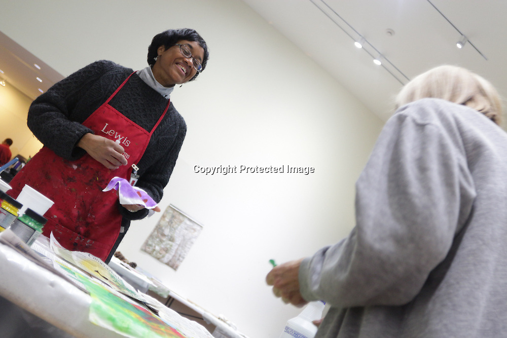 """Instructor September Krueger, left, talks to Mary Bryan during """"Create Your Own Quilt Squares"""" Sunday November 23, 2014 at the Cameron Art Museum in Wilmington, N.C. (Jason A. Frizzelle)"""