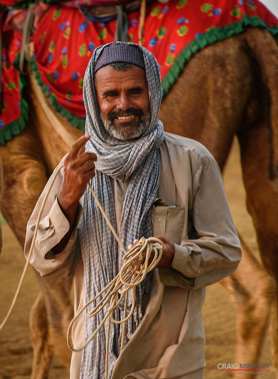 Camel Guide, in Great Thar Desert, Jaisalmer India<br /> <br /> Nikon D750 300mm  ISO 4000  f9  1/100s