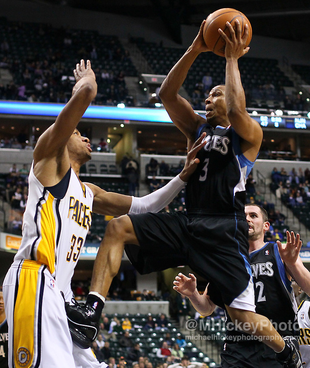 Feb. 11, 2011; Indianapolis, IN, USA; Minnesota Timberwolves point guard Sebastian Telfair (3) goes strong to the hoop against Indiana Pacers forward Danny Granger (33) at Conseco Fieldhouse. Mandatory credit: Michael Hickey-US PRESSWIRE