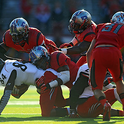 Rutgers defenders gang tackle a receiver during American Athletic Conference Football action between Rutgers and Cincinnati on Nov. 16, 2013 at High Point Solutions Stadium in Piscataway, New Jersey.