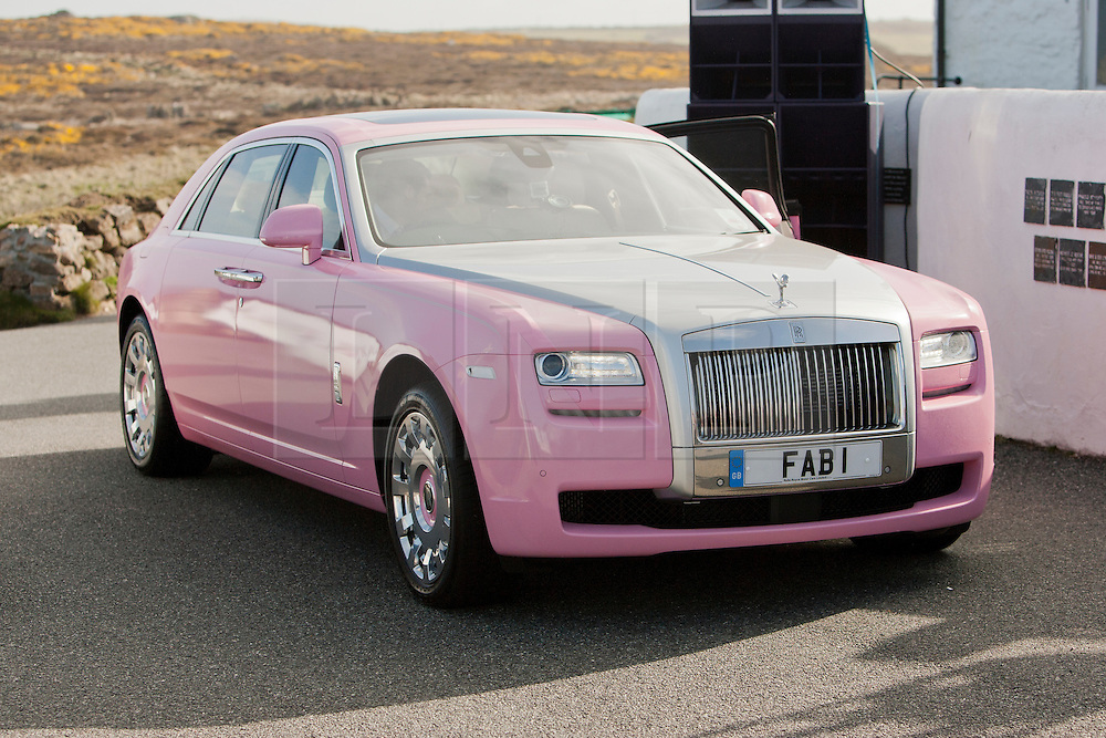 © Licensed to London News Pictures. 18/04/2013. Lands End, UK. FAB 1, a pink Rolls Royce Ghost which is to be driven from Lands End to John O'Groats by Chris Evans, Garry Barlow, James May and Professor Brian Cox. The aim is to raise 1 Million pounds for Breast Cancer Care. Photo credit : Ashley Hugo/LNP
