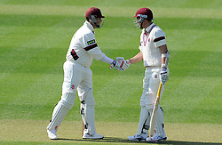 Somerset's Tom Cooper is congratulated by Somerset's Marcus Trescothick after reaching his half century..  - Photo mandatory by-line: Harry Trump/JMP - Mobile: 07966 386802 - 07/04/15 - SPORT - CRICKET - Pre Season - Somerset v Lancashire - Day 1 - The County Ground, Taunton, England.