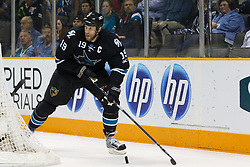 April 4, 2011; San Jose, CA, USA;  San Jose Sharks center Joe Thornton (19) skates with the puck against the Los Angeles Kings during the first period at HP Pavilion. San Jose defeated Los Angeles 6-1. Mandatory Credit: Jason O. Watson / US PRESSWIRE